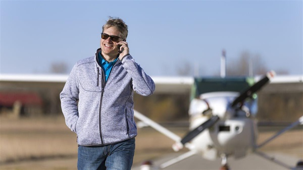 Model Lawson Phillips wearing a Men's Sweater Fleece Jacket (SKU# AOPA-MSFGR5-4) and a Pounce Puma Polo (SKU# AOPA-MPPBL5-4) with a Cessna 182. Cook Airfield (K50) Derby KS USA